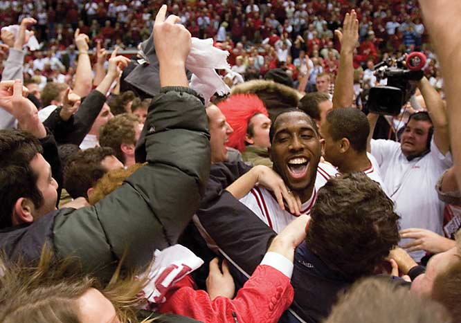 D.J. White celebrates with fans after Indiana's 71-66 victory over Wisconsin last January.