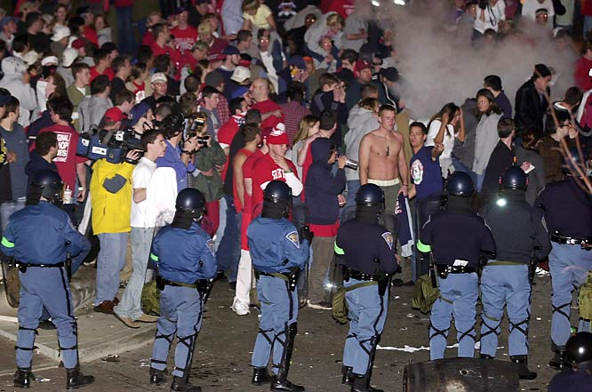 Indiana fans react after police fire tear gas into a crowd on Kirkwood Avenue after the 2002 NCAA Championship game.