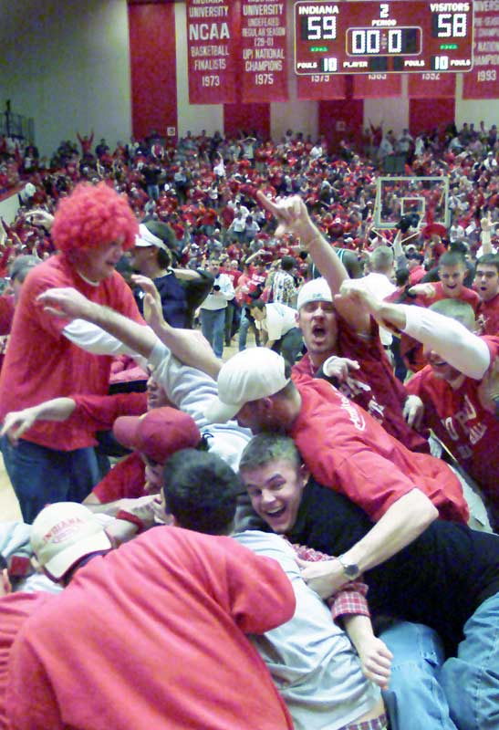 Students pile on the Hoosier players after they upset top-ranked Michigan State, 59-58, with a three-point shot at the buzzer by Kirk Haston in January 2001.