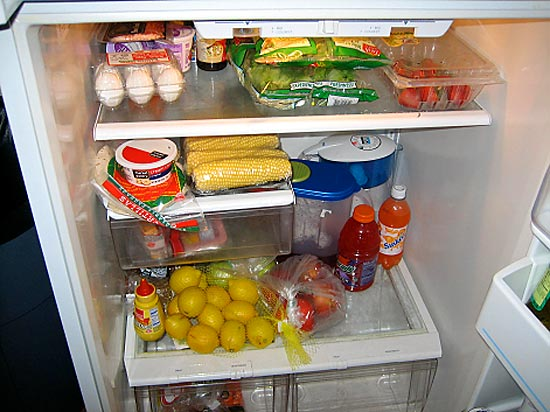 Some healthy stuff -- salad, eggs, corn, strawberries -- but honestly, who keeps a bag of lemons in their refrigerator?