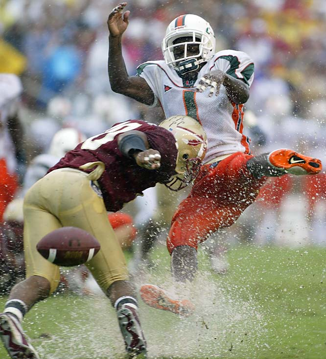 Tielemans's take:<br><br>''This was Miami at Florida State in 2003. The day started out misty and deteriorated into a downpour, but the pictures that day were incredible. Every play was awash in water spray and players flying through the air. This particular play featured one of those hits that made  the entire crowd gasp.''<br><br>Shot with a Canon EOS-1D  EF 300 f 2.8