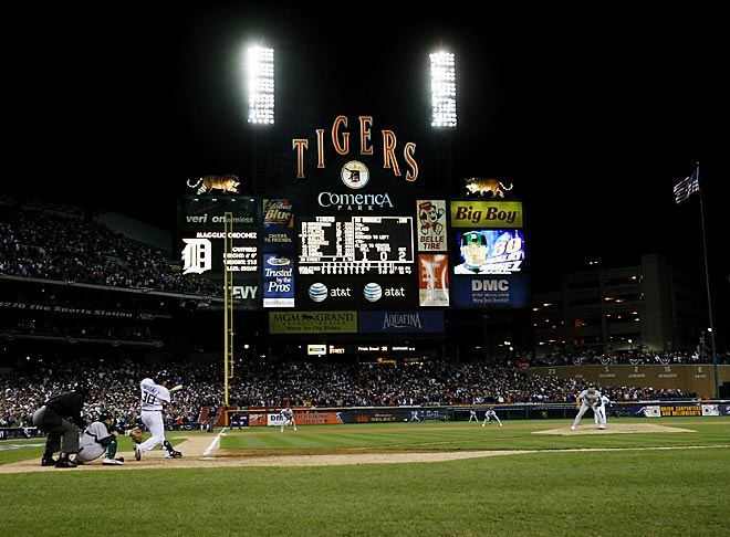 Tielemans's take:<br><br>''On a cold October night last fall, Magglio Ordonez sent Detroit to baseball heaven with this walk-off, pennant-winning blast. There always is temptation to shoot tight in this situation, but the whole story was right there on the Comerica Stadium scoreboard. Playoff baseball is sports drama at its best, and photographing the victorious underdog is ultimately why I do this job.''<br><br>Shot with a Canon EOS-1D Mark II N   EF 16-35 f 2.8 L