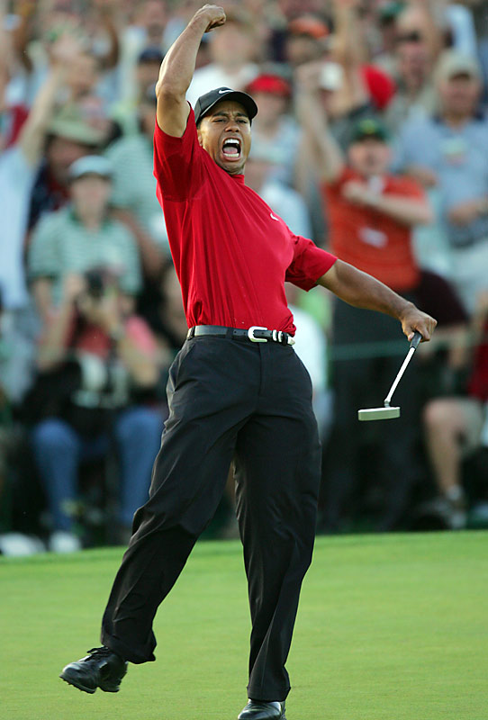 Tielemans's take:<br><br>''When Tiger lined up his final putt of the 2005 Masters, his back was to me. The chances of him celebrating his victory in my direction were slim. Just moments before, after putting towards me, he missed what would have been the clinching shot at the same hole. It was a humbling reminder of the role that luck plays in this business. Anyway, on this putt, when the ball rolled into the cup, an amazing thing happened: Tiger turned right towards me and celebrated as only he can. The fickleness of luck cuts both ways.''<br><br>Shot with a Canon EOS 1D Mark II    EF 400mm f 2.8L IS