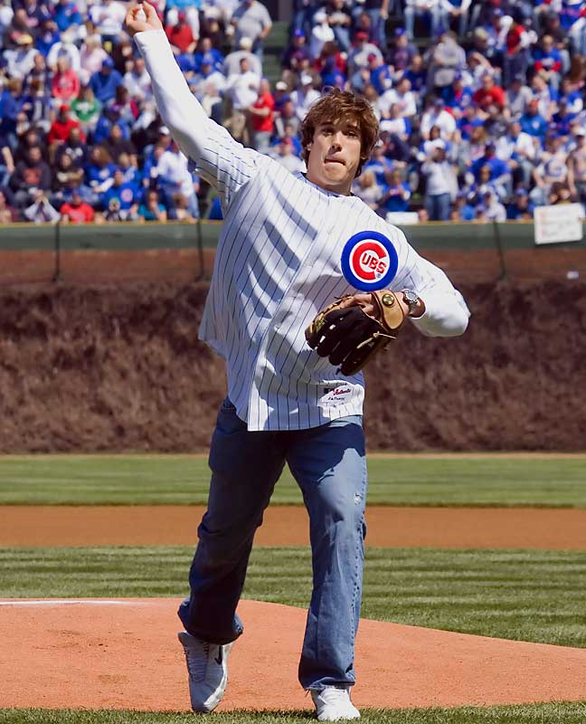 Brady Quinn tries to show former teammate Jeff Samardzija that he's not the only Notre Dame alum who can play for the Cubs. Actually, he was just throwing out the first pitch at a recent Cubs game.