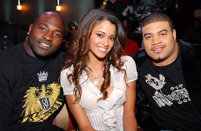To no one's surprise, former Charger Marcellus Wiley and current Charger Shawne Merriman are all smiles at the premiere party for BET's new show, Ballers, as they pose with model Claudia Jordan.
