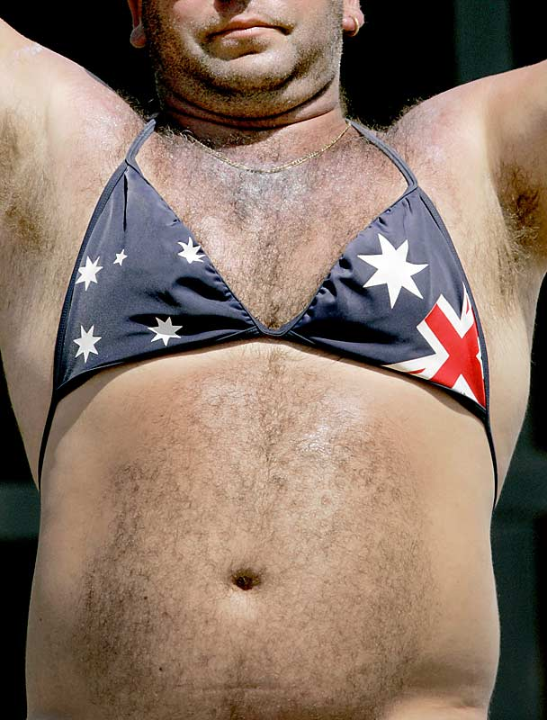 A cricket fan who should not wear a bikini top...
