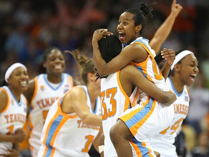 Shannon Bobbitt jumps into the arms of teammate Alberta Auguste as the Lady Vols celebrate their first championship in nine years.
