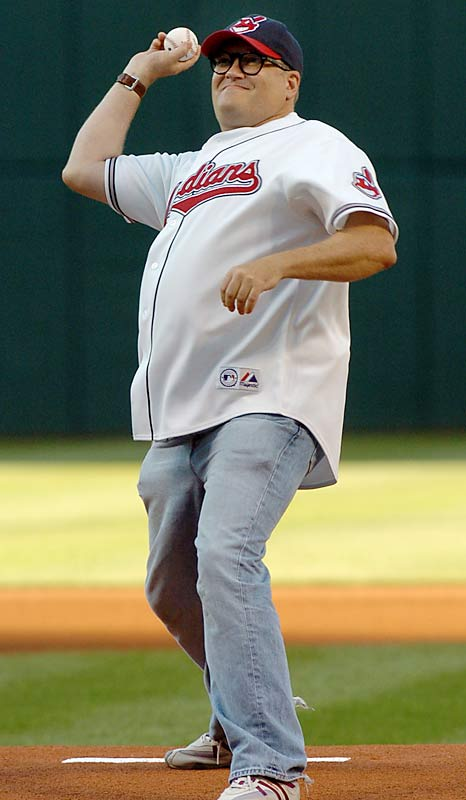 Drew Carey doesn't let his sixth right toe get in the way of throwing a pitch for his home team.