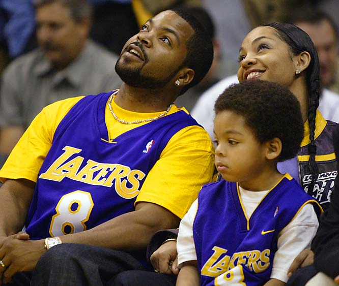 Noted California fan Ice Cube and Mrs. Kim Cube smile at the Staples Center jumbotron as little O'Shea takes interest in something more grounded.