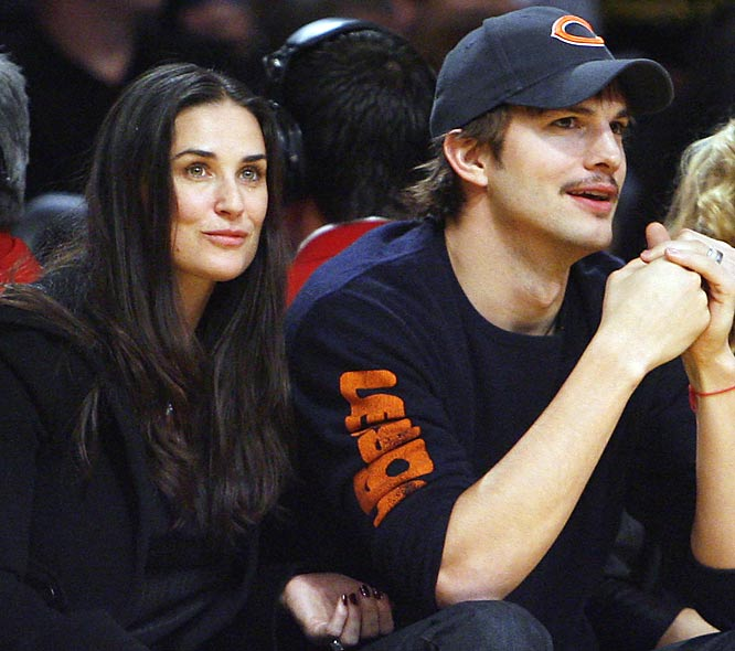 Ashton Kutcher shows his Chicago Bears pride while sitting courtside at a Laker game with wife Demi Moore.