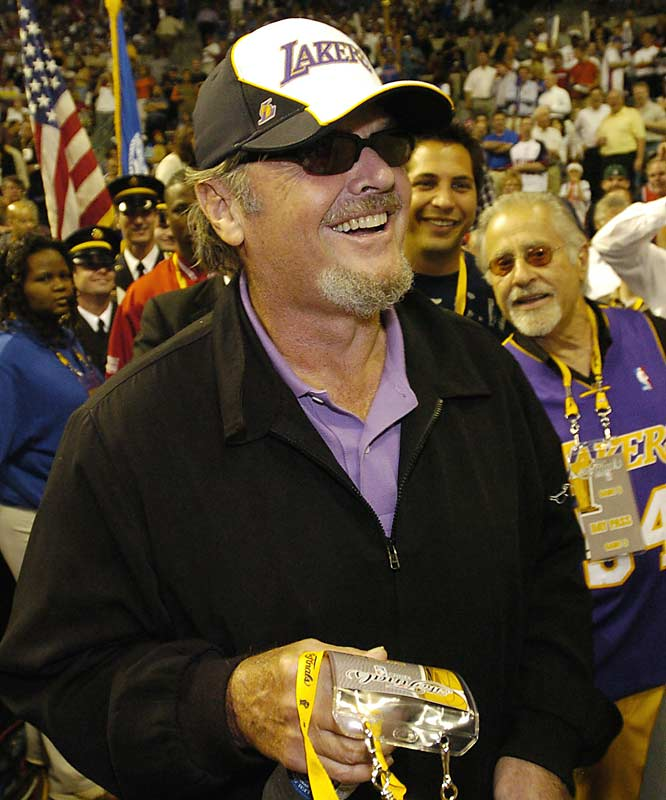 The Lakers' most famous (and possibly most devoted) fan, Jack Nicholson, enters the arena dressed in team colors.
