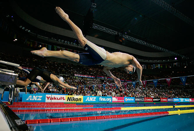 Michael Phelps dives in to the pool at the start of the men's 400m individual medley final.