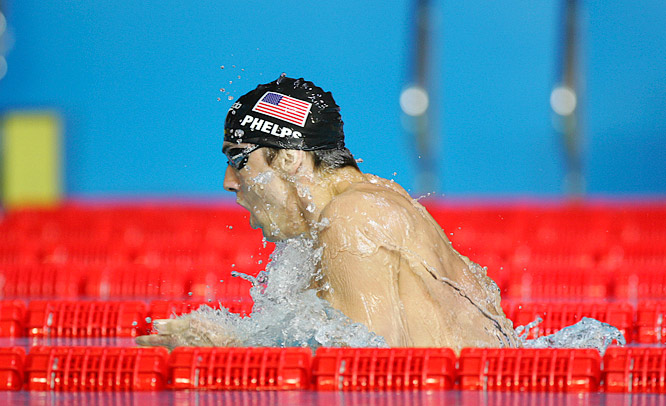 Michael Phelps powers away from the field during the breaststroke leg of the men's 400m individual medley.