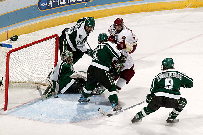 Michigan State goalie Jeff Lerg makes one of his 29 saves against B.C.