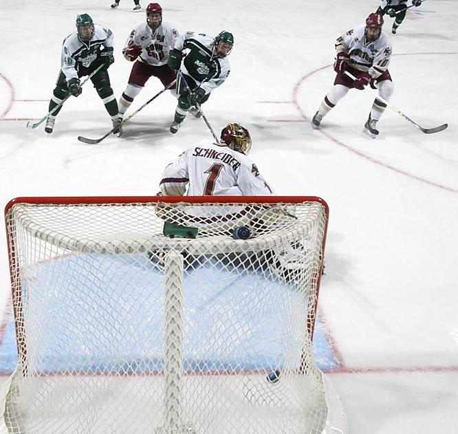 Tim Kennedy scores the tying goal in the third period. He later set up the winning score with 18.9 seconds left as Michigan State beat Boston College, 3-1, to win the NCAA Division I hockey championship Saturday night.