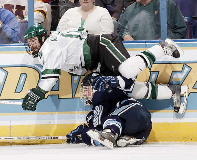 Jim McKenzie gets tripped up here but later scores off a rebound midway through the third period.