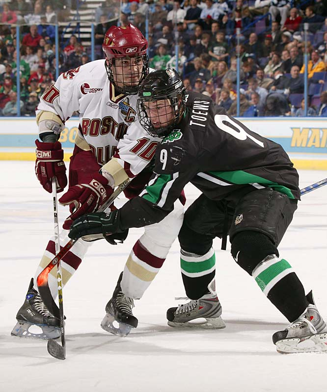 Boston College's Brian Boyle goes head-to-head with North Dakota's Jonathan Toews.