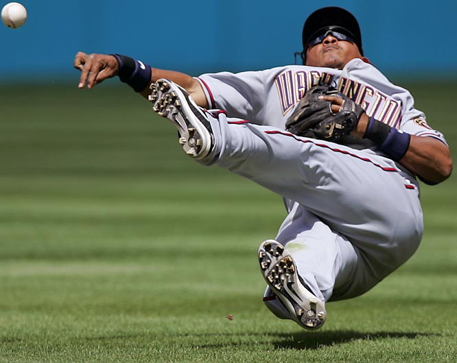 Nationals' second baseman Ronnie Belliard throws out the Marlins' Wes Obermueller in the sixth inning on Sunday. The Marlins won 12-6.