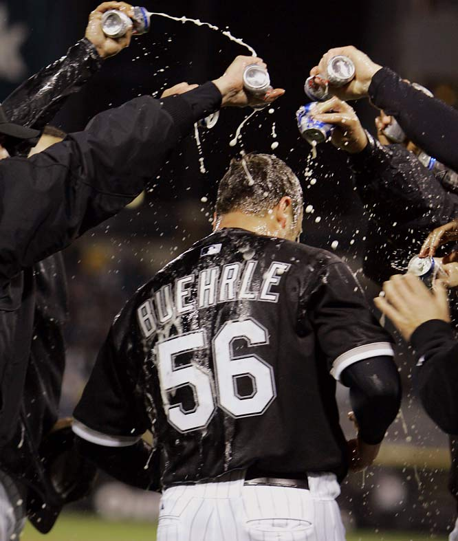 White Sox players douse teammate Mark Buehrle with beer after his one-walk no-hitter against the Rangers on April 18.  Buehrle threw 105 pitches and struck out eight in a game that took just two hours and three minutes.