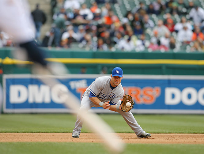 Royals' third baseman Alex Gordon fields a ball hit by the Tigers' Plácido Polanco in the sixth inning on April 18.  Polanco reached first on a throwing error by Gordon, scoring the first of three runs in the inning for Detroit. The Royals won the game 4-3 after 10 innings.