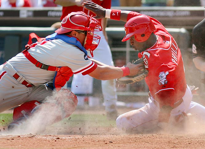 Phillies catcher Carlos Ruiz tags the Reds' Brandon Phillips out in the sixth inning on Sunday.  The Phillies won 9-3.