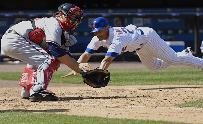 The Mets' José Valentin beats the throw home to Brian McCann to score in the sixth inning on Sunday.  The Braves won 9-6.