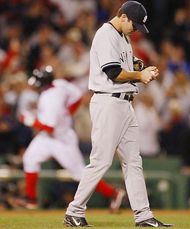 Yankees pitcher Chase Wright rubs the ball as Jason Varitek rounds the bases after hitting the fourth home run in a row for the Red Sox in the third inning on Sunday night.  Manny Ramirez, J.D. Drew and Mike Lowell had already taken Wright deep in Boston's 7-6 victory to sweep the Yankees.