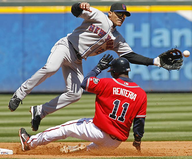 The Braves' Edgar Renteria steals second ahead of the throw to the Mets' Jose Valentin on Sunday.  After losing their first game against the Mets on Friday, Atlanta came back to win the series 2-1.