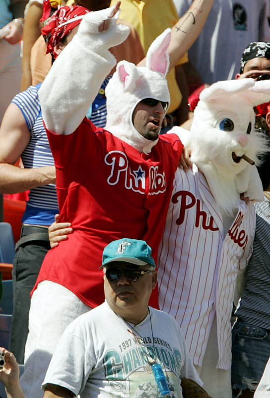 "Phillies' fans dressed in rabbit costumes sing ""Take Me Out to the Ball Game"" during the seventh inning stretch of the game against the Marlins on Easter Sunday."