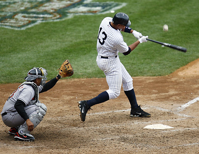 The Yankees' Alex Rodriguez hits a two-run homer in the first inning off the Orioles' Steve Trachsel on Saturday.  A-Rod later hit a grand slam in the bottom of the ninth to win the game 10-7.