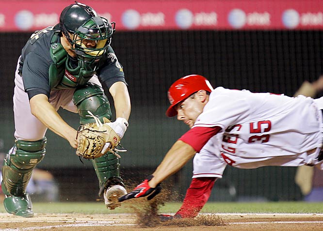 A's catcher Jason Kendall tags out the Angels' Casey Kotchman trying to score from second during their game Thursday.  Oakland won 4-3.