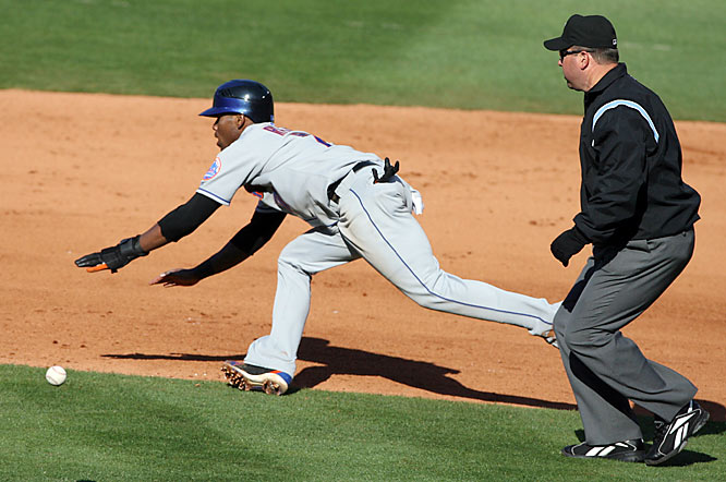 The Mets' Jose Reyes steals second base Saturday against the Braves.  Reyes stole three bases last week and hit three triples during the Mets' three-game series with Atlanta.