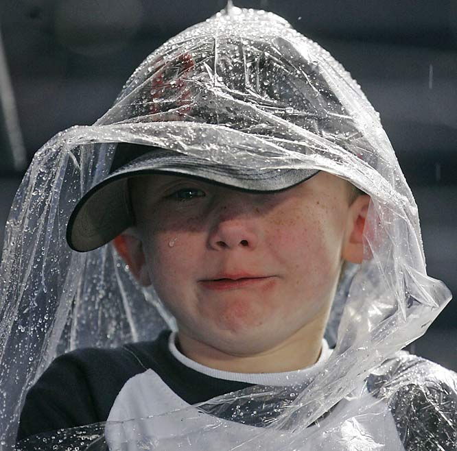 Parker Bowen, 6, cries after it was announced the Braves game against the Marlins at Turner Field had been rained out on Saturday.  A Nor'easter washed out two MLB games on Saturday and six more on Sunday.