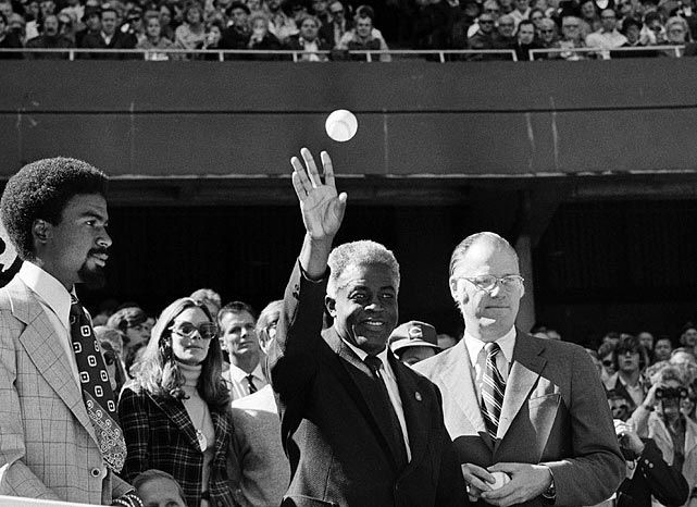 Robinson, pictured here with commissioner Bowie Kuhn, threw out the ceremonial first pitch prior to Game 2 of the World Series on Oct. 15, 1972 -- the 25th anniversary of his major league debut.