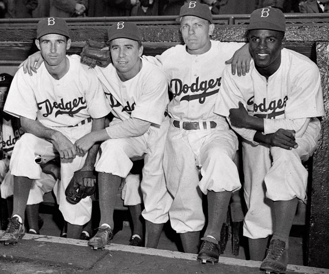 On April 15, 1947, Robinson's first day in the majors, he lined up with teammates (from left) John Jorgensen, Pee Wee Reese and Ed Stanky.