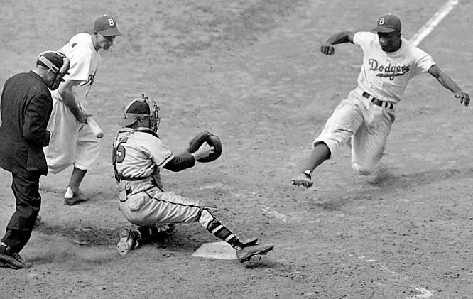 Robinson steals home against Braves pitcher Bill Voiselle and catcher Bill Salkeld on Aug. 22, 1948, at Ebbets Field.
