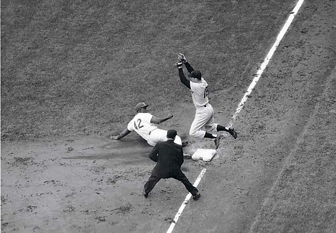 Robinson slides hard into Yankees third baseman Gil McDougald during the 1955 World Series.