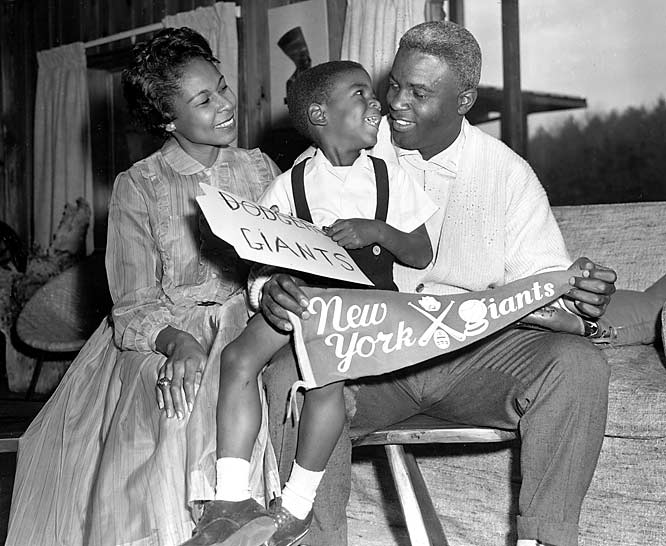 """Robinson with wife, Rachel, and their son David at their home in Stamford, Conn., on Dec. 13, 1956, the day Robinson was traded from the Dodgers to the rival New York Giants. Robinson refused to report to the Giants and retired instead."""""""