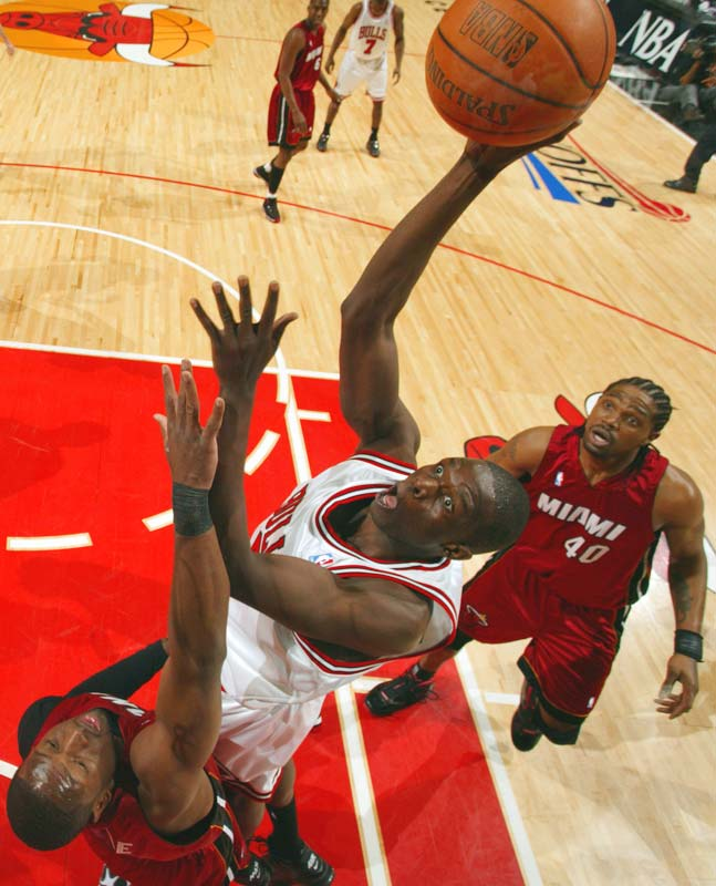 Luol Deng scored a game-high 33 points on 14-of-22 shooting and delivered some clutch plays down the stretch as the Bulls held off the defending champion Heat.