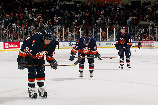 (Left to right) Ryan Smyth, Marc-Andre Bergeron and Jason Blake stand dejected after a tough loss to the Sabres, putting the Isles down 2-1 in the series.
