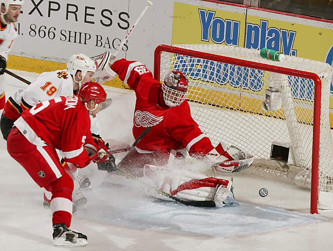 Red Wings goalie Dominik Hasek makes the save on Wayne Primeau during first period action.  Hasek faced only 15 shots from the Flames.