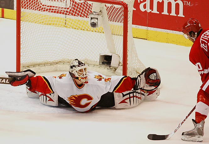 Flames goalie Miikka Kiprusoff sprawls across his crease to block a shot from Henrik Zetterberg.  Kiprusoff made 48 saves in the loss to Detroit.