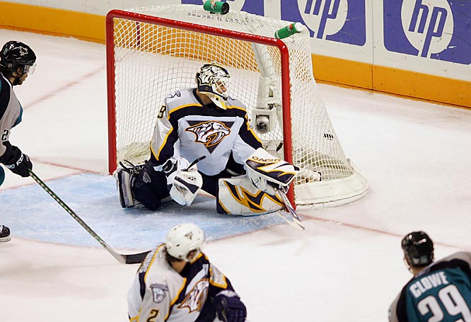 Goalie Tomas Vokoun watches the shot from Sharks forward Ryane Clowe get past him for a goal in the second period.
