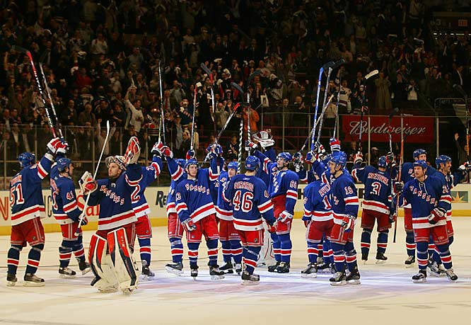 The Rangers salute their fans at Madison Square Garden after sweeping the Thrashers in four games and winning their first playoff series in 10 years.