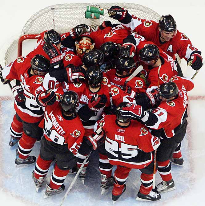 The Senators celebrate with their netminder, Ray Emery, after shutting out the Penguins to win the series 4-1.