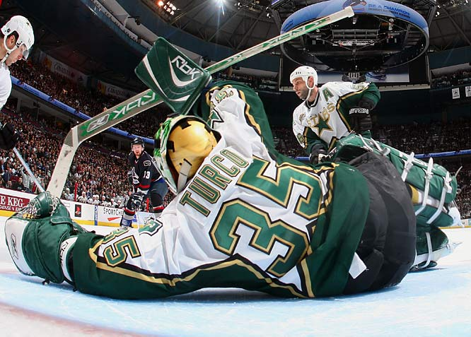 Stars goalie Marty Turco made 35 saves in a shutout against the Canucks to even the series.