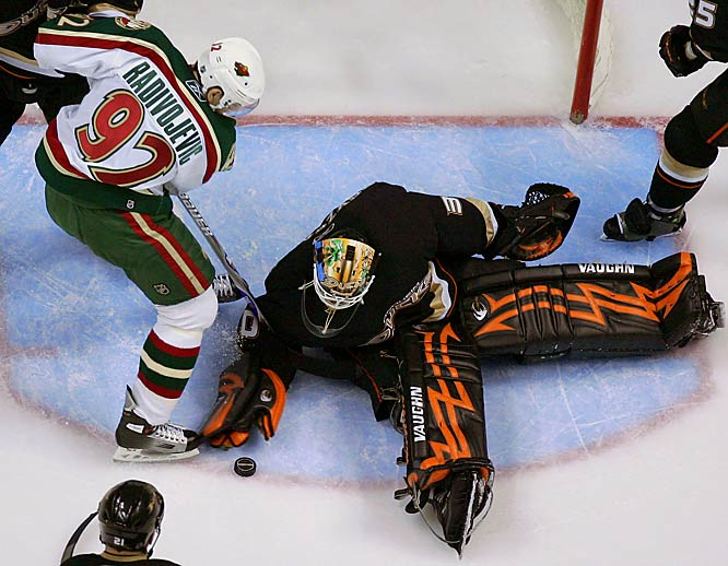 Ilya Bryzgalov blocks a shot by right wing Branko Radivojevic in the third period.  Anaheim coach Randy Carlyle started Bryzgalov in place of Jean-Sebastian Giguere, who rejoined the team after learning his newborn son, born with a deformed right eye, would not lose vision in his left eye.