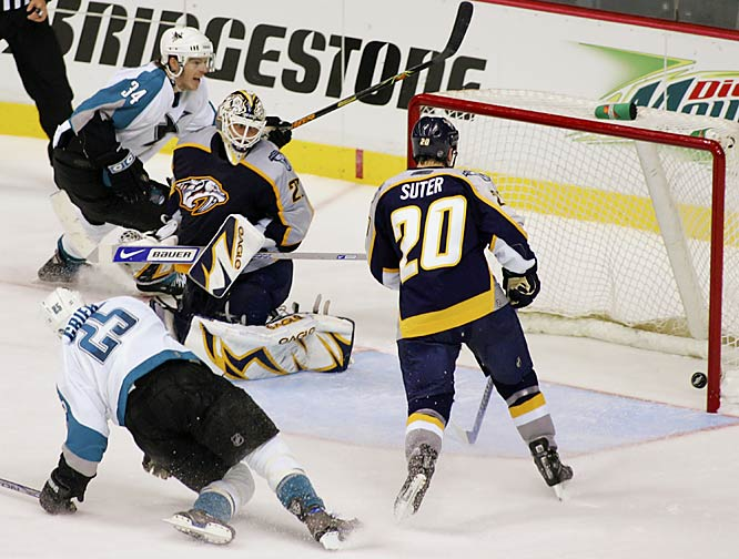 Sharks center Patrick Rissmiller scores at 8:14 of the second overtime as Predators goalie Tomas Vokoun and defenseman Ryan Suter watch the puck go in the net.