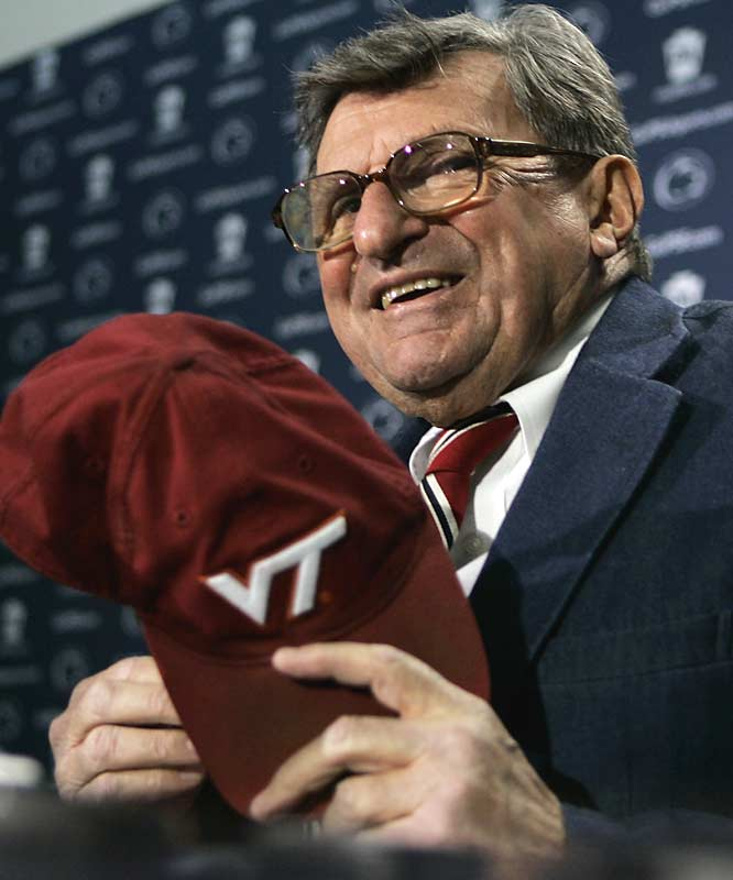 Penn State coach Joe Paterno holds a cap given to him by the family of Tech student Jeremy Herbstritt, who was killed in the shootings.