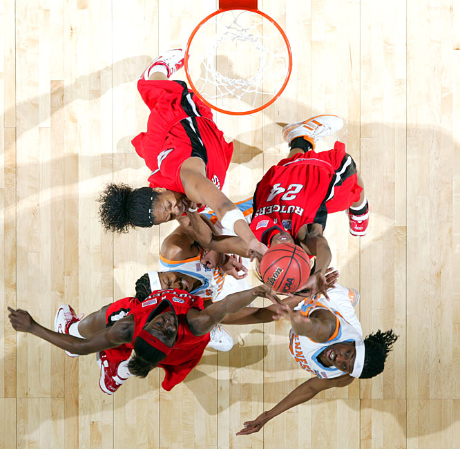 A group of players fights for a rebound. Tennessee outrebounded Rutgers 42-34 in the game.
